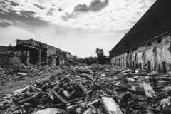 Earthquake or war aftermath or hurricane or other natural disaster, broken ruined buildings, pills of concrete garbage stock image
