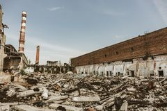Earthquake or war aftermath or hurricane or other natural disaster, broken ruined buildings, pills of concrete garbage stock images