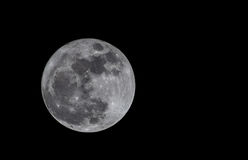 Earths Companion. Our beautiful moon in the night of autumn stock photo