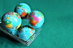 Earths globe in shopping cart. Earth globe in shopping cart. How many Earths do we need royalty free stock photos