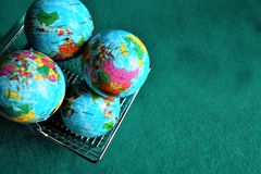 Earths globe in shopping cart. Earth globe in shopping cart. How many Earths do we need royalty free stock images