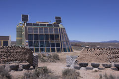 Earthship Biotecture. Earthship Biotec tire house in Taos New Mexico Stock Photos