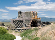 Earthship under construction. Sustainable building - an earthship under construction in Taos County, NM Stock Image