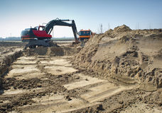 Earthwork. Hydraulic excavator and truck at work Royalty Free Stock Photo