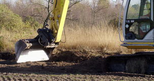 Earthwork with an excavator for nature restoration stock video footage
