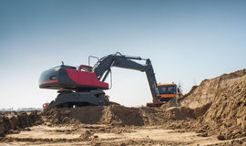 Earthwork. Hydraulic excavator and truck at work Royalty Free Stock Photography