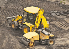Earthwork machines. Parked in underconstruction territory Royalty Free Stock Photography