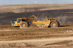 Earthwork smoothing. A large grader smoothing the terrain for a future subdivision in Colorado Stock Photo