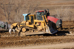 Earthwork smoothing. A large grader smoothing the terrain for a future subdivision in Colorado Stock Photos