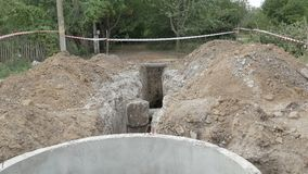 Earthwork, water supply. Earthworks, the construction of a water pipe is fenced with an alarm tape stock video footage