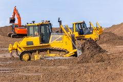 Free Earthworks Construction Dozer Excavator Machines Royalty Free Stock Photography - 118554017