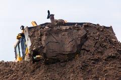 Earthworks Construction Operating Dozer Machine royalty free stock photos