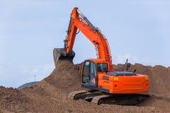 Earthworks Construction Operating Excavator Machine royalty free stock photo