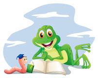 An earthworm and a frog reading Stock Photo