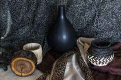 Earthy colored still life photograph with archaic wooden and ceramic objects stock photo