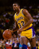 Earvin Magic Johnson. Los Angeles Lakers legend Magic Johnson dribbles the ball up the court. (Image taken from color slide