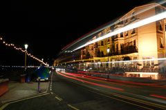 Easbourne Sea Front at Night. A view along Royal Parade as traffic passes by, Eastbourne, England, UK at night Stock Images