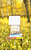 Easel in autumn forest Stock Images