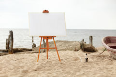 Easel in the beach Stock Image