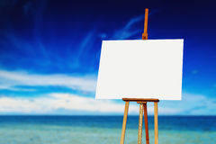 Easel with Blank Canvas on the Beach Stock Image