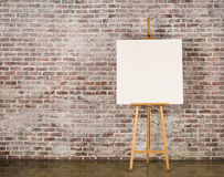 Easel with blank canvas Stock Image