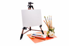 Easel with a blank canvas. And brush the right krastki Stock Photography