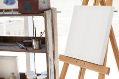 Easel with blank canvas Stock Images