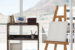Easel with blank canvas. In drawing room Royalty Free Stock Photography