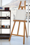 Easel with blank canvas. In drawing room Royalty Free Stock Photo