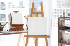 Easel with blank canvas. In drawing room Royalty Free Stock Images