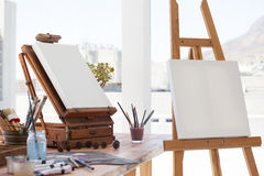 Easel with blank canvas. In drawing room Stock Photo