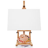 Easel with blank canvas palette paint and brushes Stock Images
