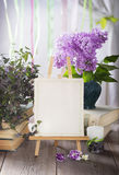 Easel with blank white card. Wedding invitation in retro style Stock Photo