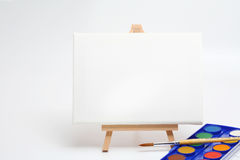 Easel with brush and watercolors Royalty Free Stock Images