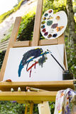 Easel with canvas in a garden Stock Photo