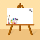 Easel with canvas. Wooden easel with blank canvas and goods of the artist Royalty Free Stock Photos