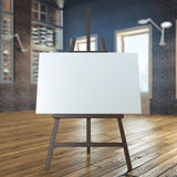 Easel with empty canvas in interior Royalty Free Stock Image