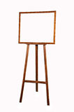 Easel with a frame. A fotoramka stands on an easel Royalty Free Stock Images
