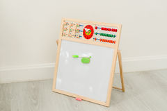 Easel  on grey wooden floor and white Stock Photos