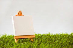 Easel on a meadow. Advertising promotion Royalty Free Stock Image