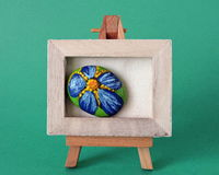 Easel with painted flower Stock Photos