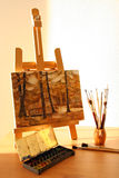 Easel with painting Royalty Free Stock Photo