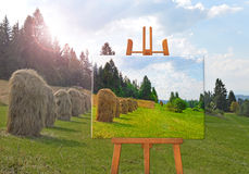 Easel with painting on canvas on landscape Stock Photo