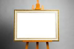 Easel with painting frame Stock Photography