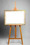 Easel with painting frame Royalty Free Stock Photos