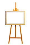 Easel with painting frame Stock Photo