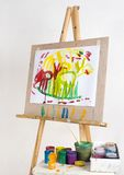 Easel and paints Stock Images