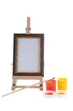 Easel, paints and bruch. Stock Photo