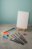 Easel, paints and brushes Stock Photography