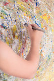 Easel paints a picture Stock Images